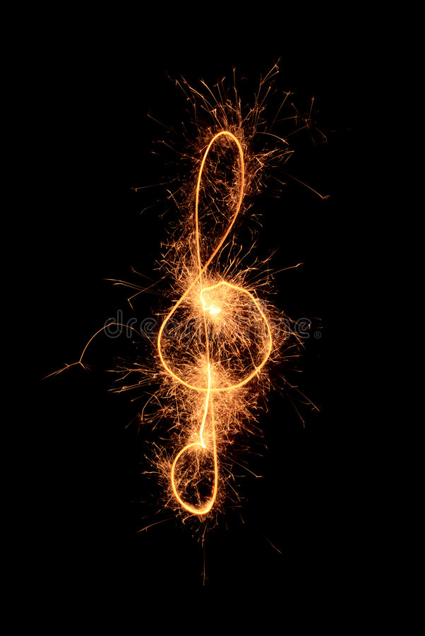 Sparkler music clef royalty free stock photos