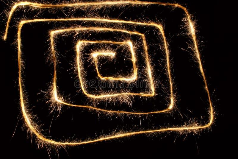 Sparkler spiral square stock photography