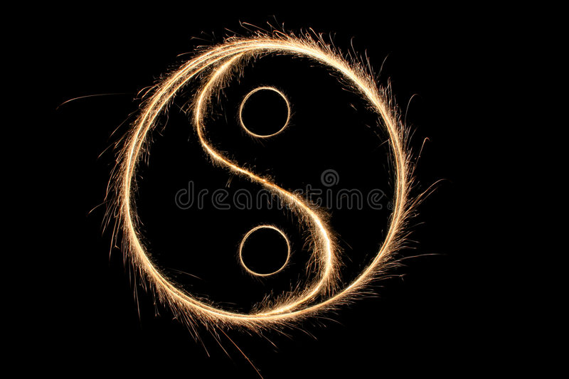 Sparkler ying yang photographie stock