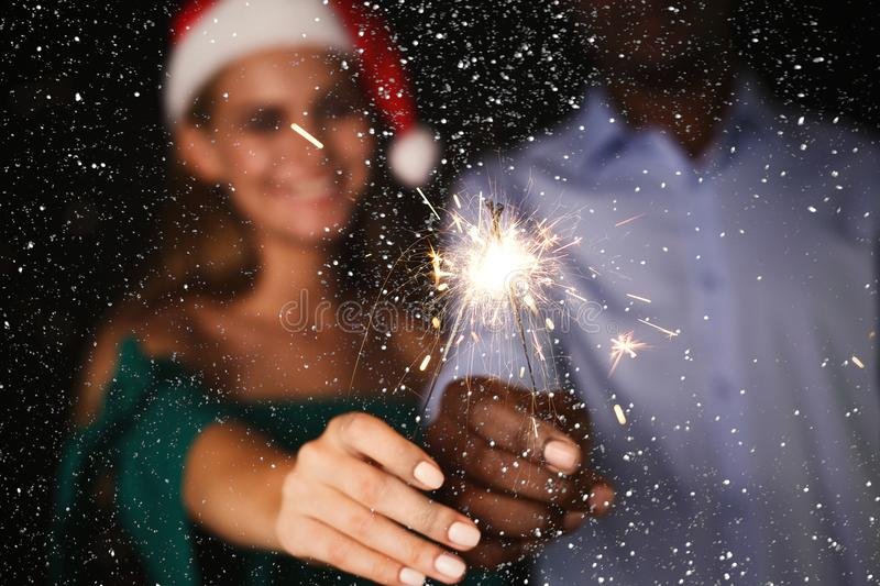 Sparklers background. Cropped shot of young people at celebration party royalty free stock photo