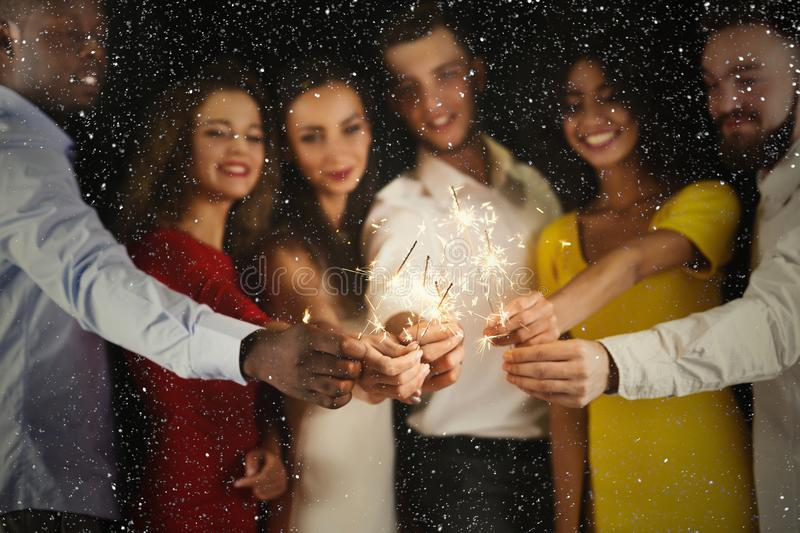 Sparklers background. Young people at celebration party royalty free stock photo