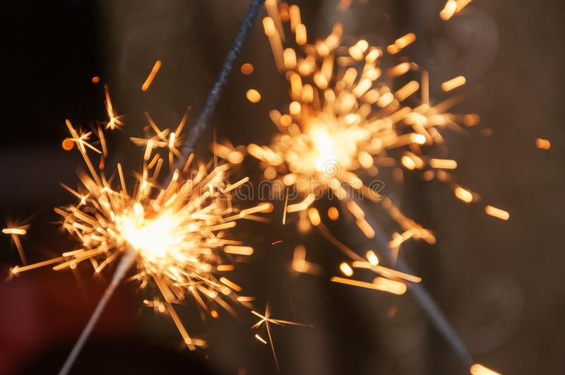 Sparklers on a dark background, selective focus royalty free stock photo