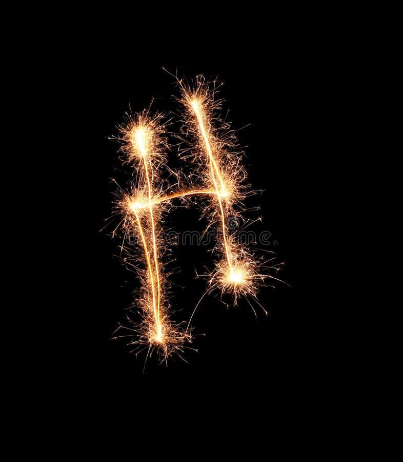 Sparklers tworzy list H na ciemnym tle obrazy royalty free