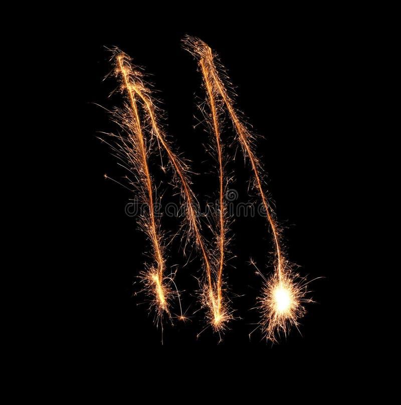 Sparklers tworzy list M na ciemnym tle obrazy royalty free
