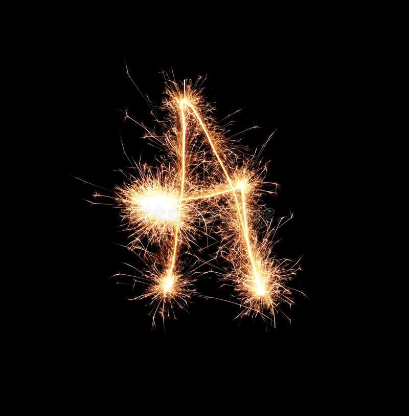 Sparklers tworzy list A na ciemnym tle zdjęcie royalty free