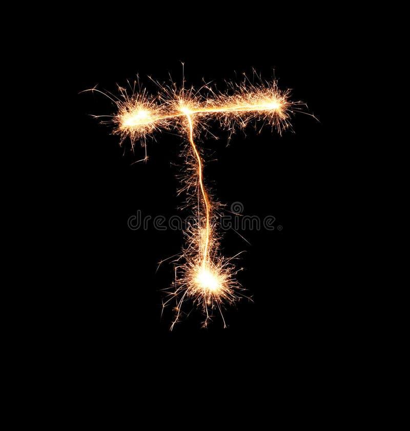 Sparklers tworzy list T na ciemnym tle zdjęcia royalty free