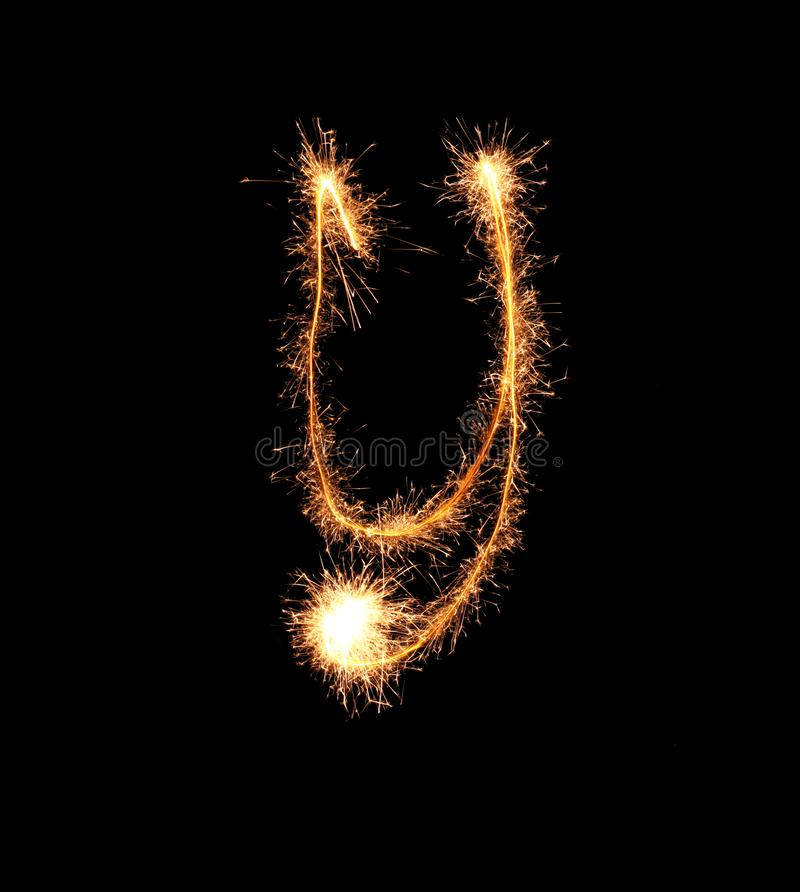 Sparklers tworzy list Y na ciemnym tle obraz stock