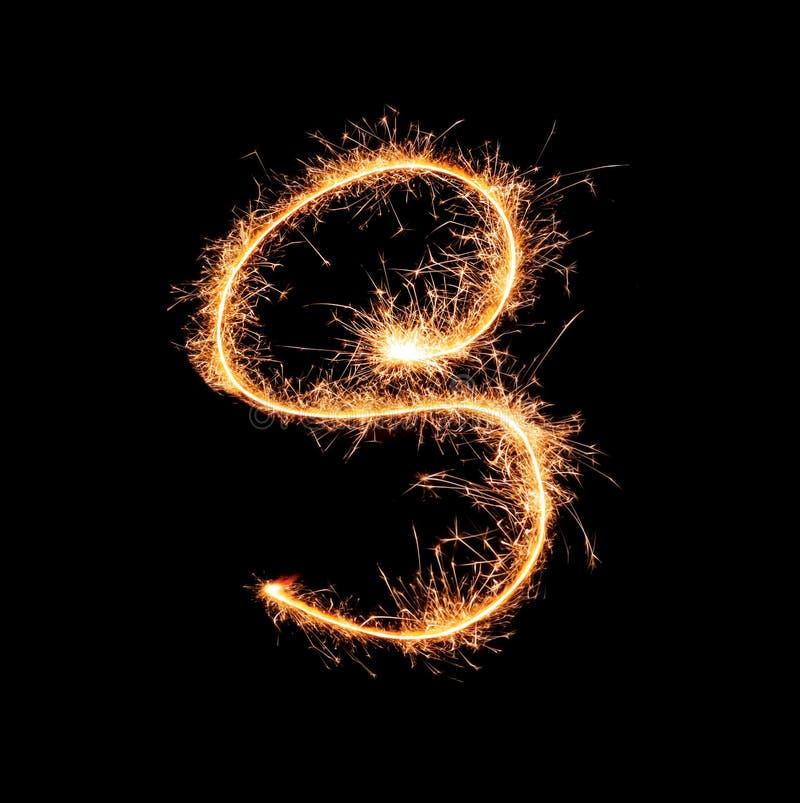 Sparklers tworzy listowego S na ciemnym tle fotografia stock