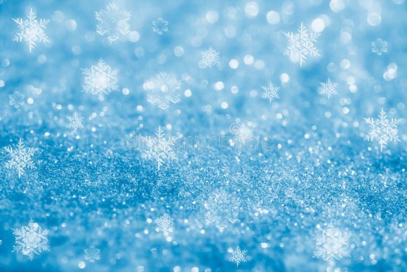 sparkles снежка яркия блеска хлопьев предпосылки голубые стоковая фотография rf