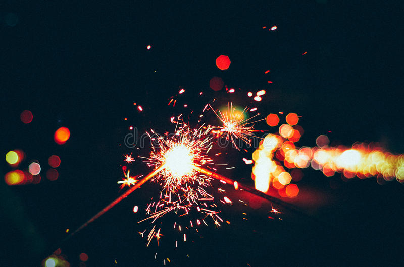 Sparkles,bringing people together. Sparkles during the festival of diwali stock photos