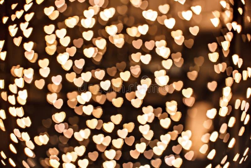 Sparkles Defocused do amarelo - coração do ouro foto de stock