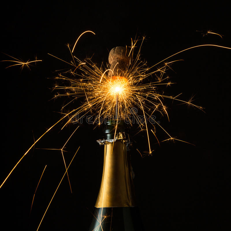 Sparkling champagne popping. A bottle of champagne with sparkling popping cork Taken in studio with a 5D mark III royalty free stock photography