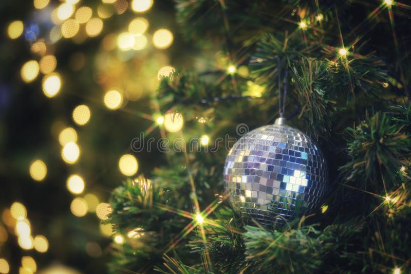 Sparkling Christmas ball decorating on Christmas tree and blurred bokeh light. Background, ball, blur, blurred, bokeh, branch, bright, brilliant, celebrate stock image