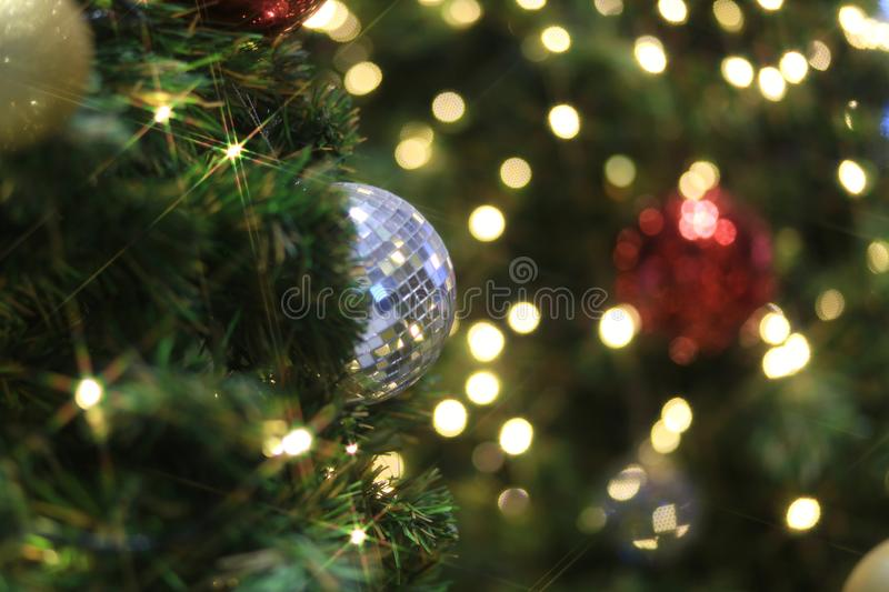 Sparkling Christmas ball decorating on Christmas tree and blurred bokeh light. Background, ball, blur, blurred, bokeh, branch, bright, brilliant, celebrate stock photo