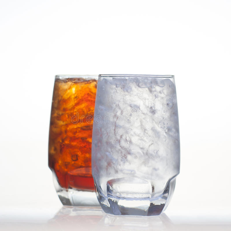 Sparkling cola drinks with water soda and ice stock images