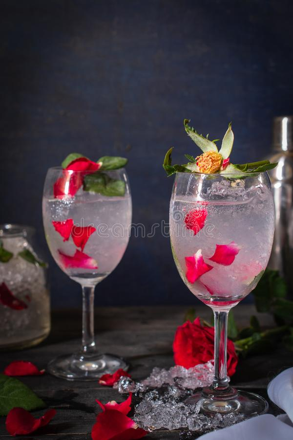 Sparkling cold water detox with rose and ice on the wood table there are rose, diferance glass, same object, cocktail shaker and. Ice placed around close up royalty free stock photos