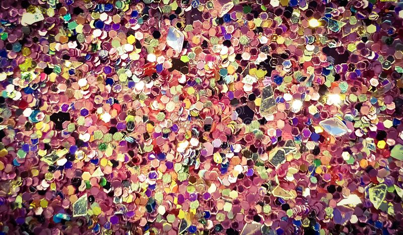 Sparkling colorful sparkles glitter glam background. Wallpaper royalty free stock images