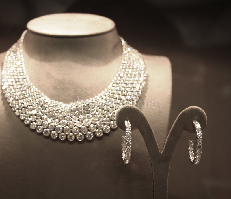 Sparkling Diamond Necklace. And Pair of Earrings on Display in Store Window stock photography