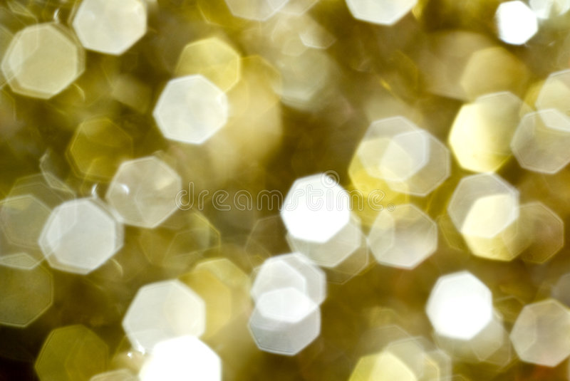 Sparkling gold. Lens diffusion effect of a christmass decoration stock photography