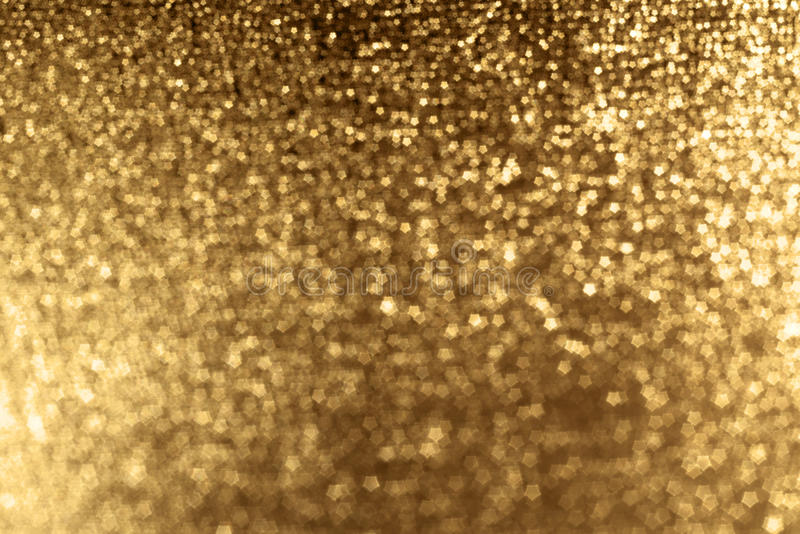 Sparkling Gold Background. A gold glittering sparkly background