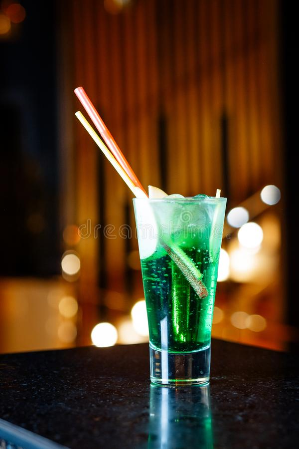 Sparkling green cocktail with fruit in a glass stock image