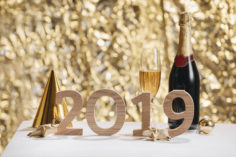 Sparkling New Year background, copy space. Champagne with decorations on New Year's Day royalty free stock photography