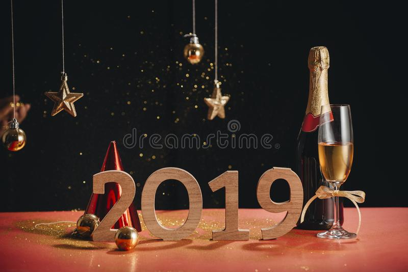 Sparkling New Year background, copy space. Champagne with decorations on New Year's Day royalty free stock images
