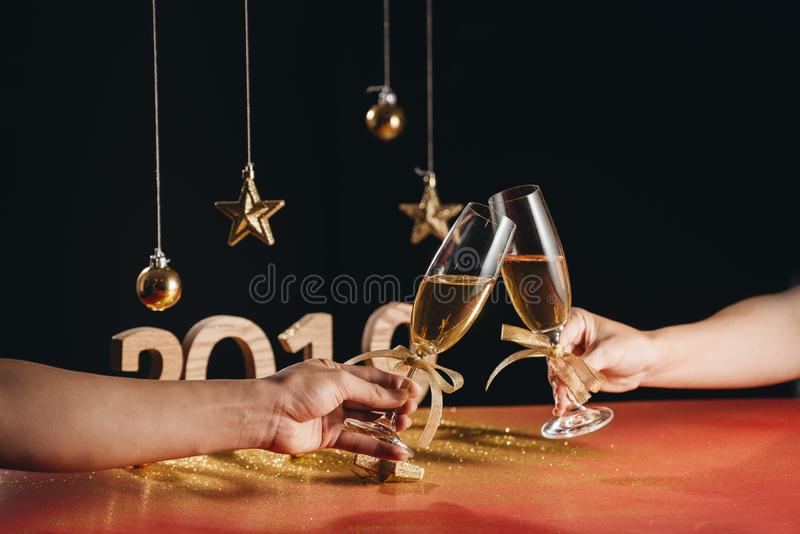 Sparkling New Year background, copy space. Champagne with decorations on New Year's Day royalty free stock photo