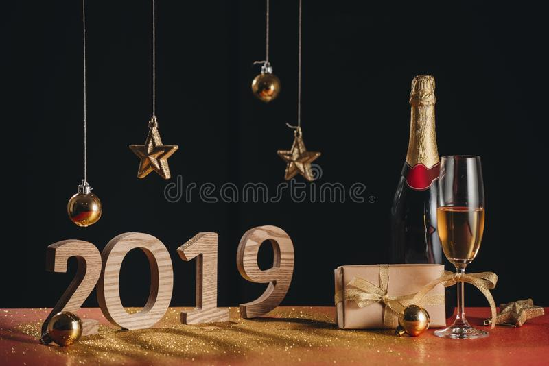 Sparkling New Year background, copy space. Champagne with decorations on New Year. `s Day royalty free stock photos