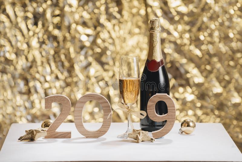 Sparkling New Year background, copy space. Champagne with decorations on New Year stock images