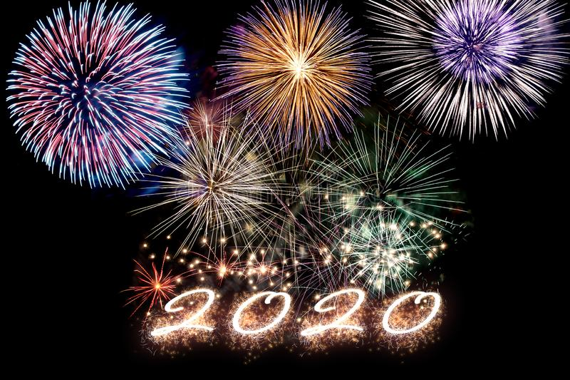 Sparkling number 2020 with fireworks. Aparkling number 2020 with fireworks on dark background. Hew Year royalty free stock image