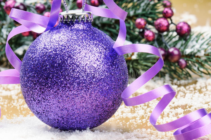 Sparkling purple Christmas ball stock images