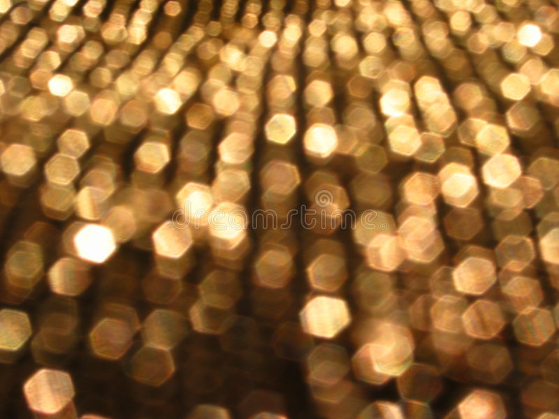 Sparkling Sequins. Blurred closeup of sequins sparkling in the light