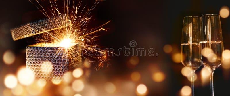 Sparkling surprise gift with golden bokeh stock photos