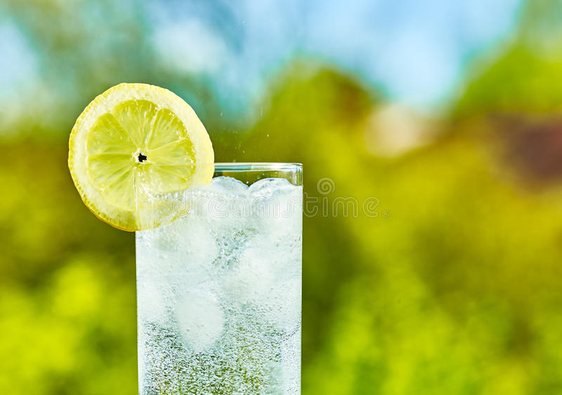 Sparkling water and lemon slice stock photography