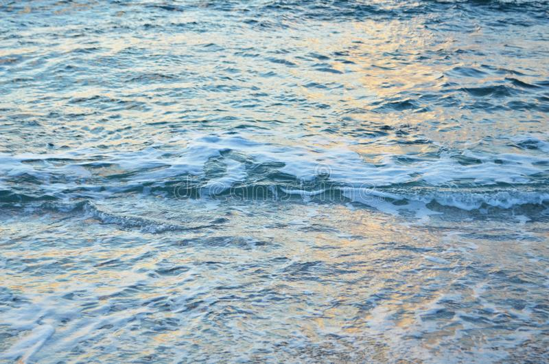 Sparkling water surface on sunset.  Nature background concept. Image royalty free stock photography