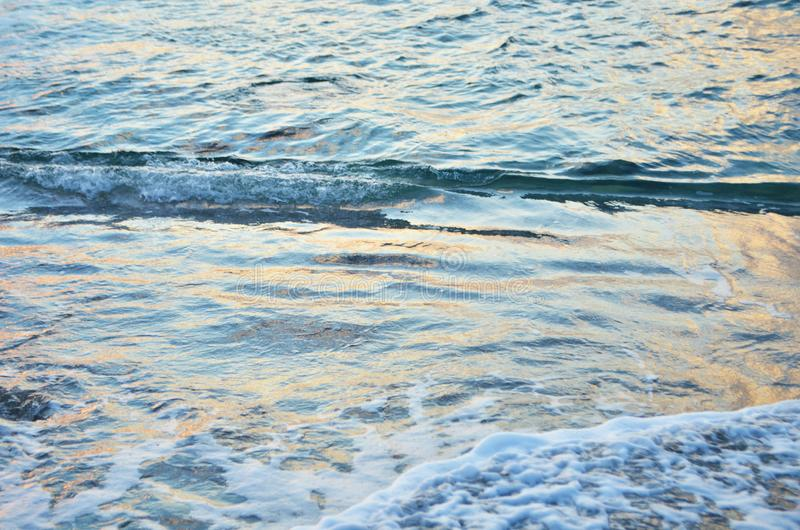 Sparkling water surface on sunset. Nature background concept. Image stock photo