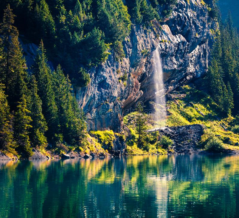 Sparkling waterfall on the Oeschinensee Lake. Splendid summer morning in the Swiss Alps, Kandersteg village location, Switzerland, stock image