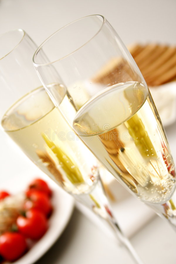 Sparkling wine with appetiser royalty free stock photo