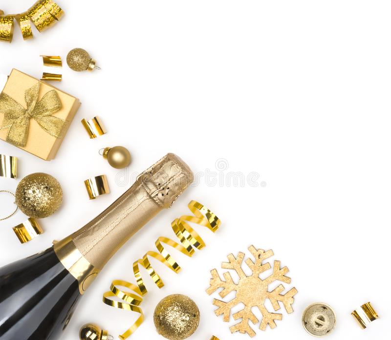Sparkling wine bottle and Christmas golden decorations on white background royalty free stock image