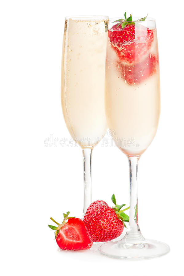 Sparkling wine (champagne) and strawberry royalty free stock photo