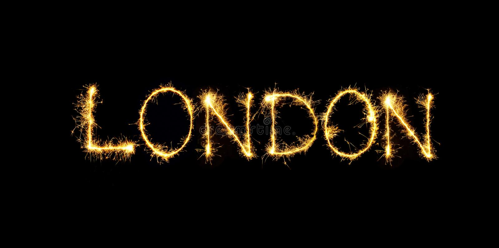 Sparkling word London isolated on black background royalty free stock photo