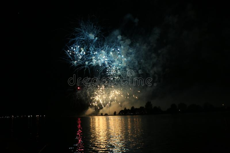 Sparkly Fireworks Display. A sparkly fireworks display over water stock photos