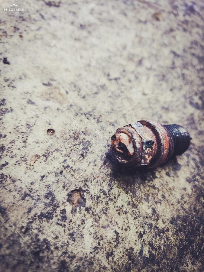 Sparkplug on cement stock images