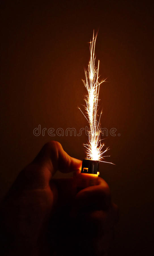 Sparks from the cigarette lighter. royalty free stock images