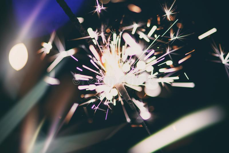 Sparks in the dark. Sparks. Christmas and New Year time. Magic light. Fire, black, flame, hot, abstract, energy, heat, bright, yellow, night, danger, burn royalty free stock photos