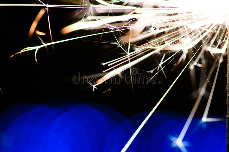 Sparks in the dark. Sparks. Christmas and New Year time. Magic light. Abstract, black, bright, burn, danger, electric, energy, fire, flame, flames, glow royalty free stock photos