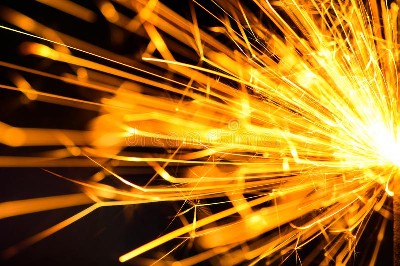 Sparks in the dark. Sparks. Christmas and New Year time. Magic light. Abstract, black, bright, burn, danger, electric, energy, fire, flame, flames, glow royalty free stock image