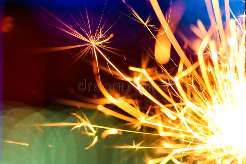 Sparks in the dark. Sparks. Christmas and New Year time. Magic light. Abstract, black, bright, burn, danger, electric, energy, fire, flame, flames, glow royalty free stock images