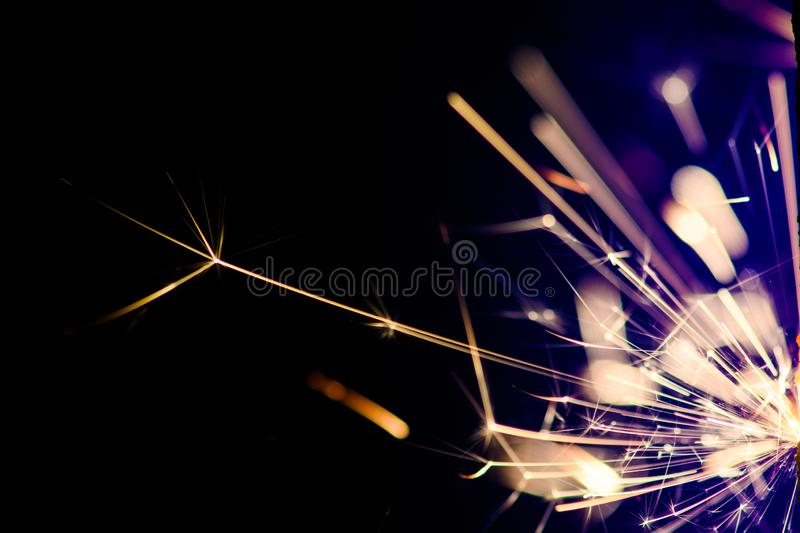 Sparks in the dark. Sparks. Christmas and New Year time. Magic light. Abstract, black, bright, burn, danger, electric, energy, fire, flame, flames, glow royalty free stock photography